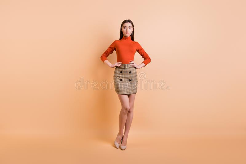 Full length body size photo of charming cute nice beautiful coach posing confidently wearing red turtleneck checkered. Full length body size photo of charming stock images