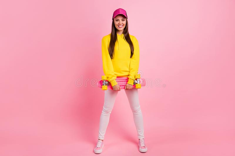 Full length body size photo of cheerful charming cute beautiful sporty girlfriend ready to skateboard wearing yellow royalty free stock photos