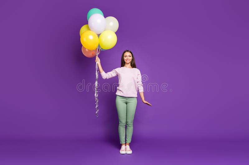 Full length body size photo of cheerful charming gorgeous fascinating girl holding balloons filled with helium isolated royalty free stock images