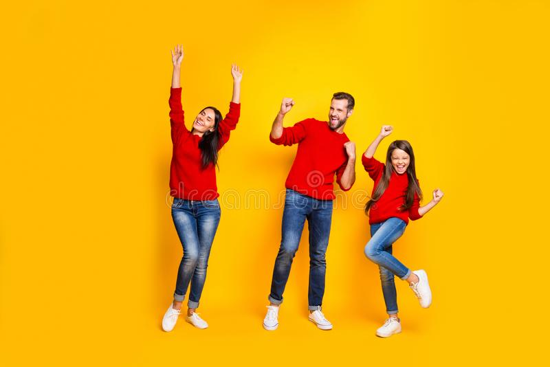 Full length body size photo of cheerful charming nice cute trendy stylish family wearing jeans denim red sweaters royalty free stock image