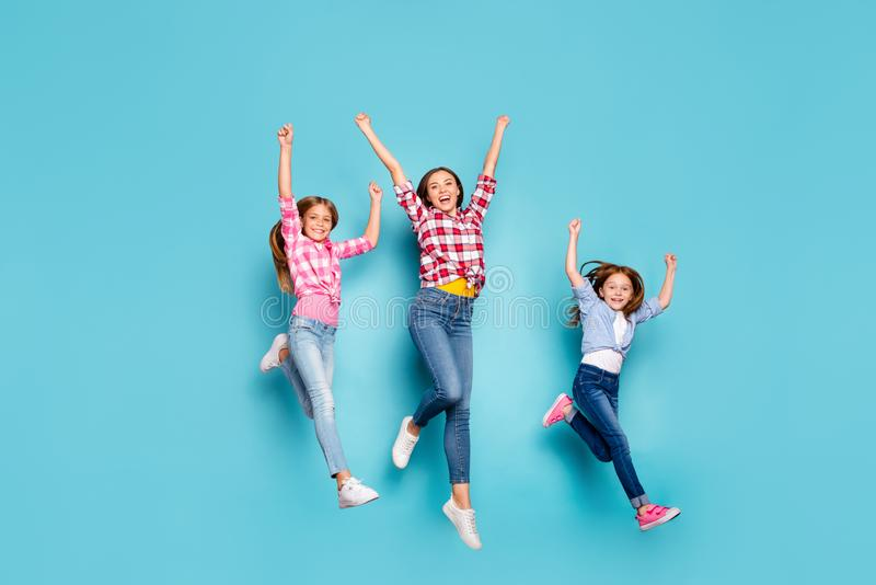 Full length body size photo of cheerful friendly white family enjoying pin-up winning running competitions while royalty free stock photo