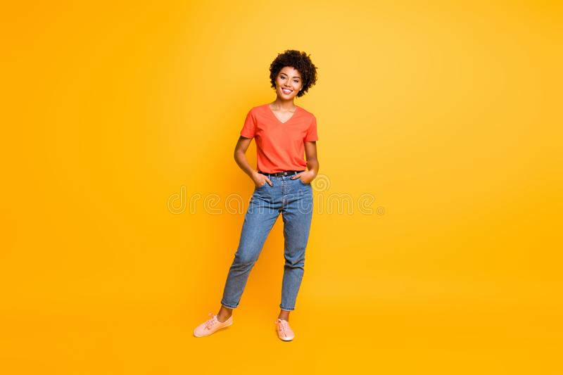 Full length body size photo of cool swag good black millennial girl posing in front of camera showing her coolness stock photo