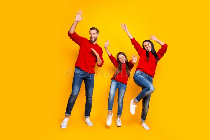 Full length body size photo of crazy cheerful nice hilarious family dancing on weekend in motion screaming about sales stock photography