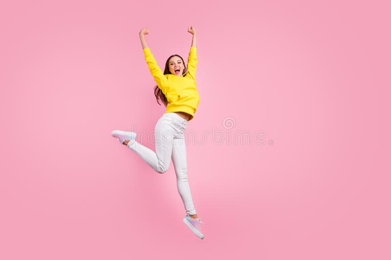 Full length body size photo of cute charming nice pretty sweet girlfriend having reached finish line first raising hands. Full length body size photo of cute royalty free stock images