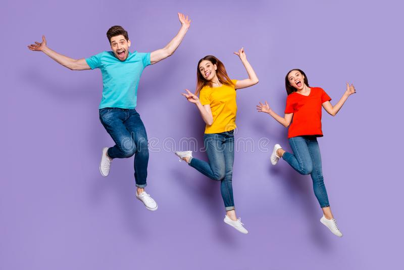 Full length body size photo of group crowd of three carefree hipsters showing tongue-out v-sign flying up with open royalty free stock images