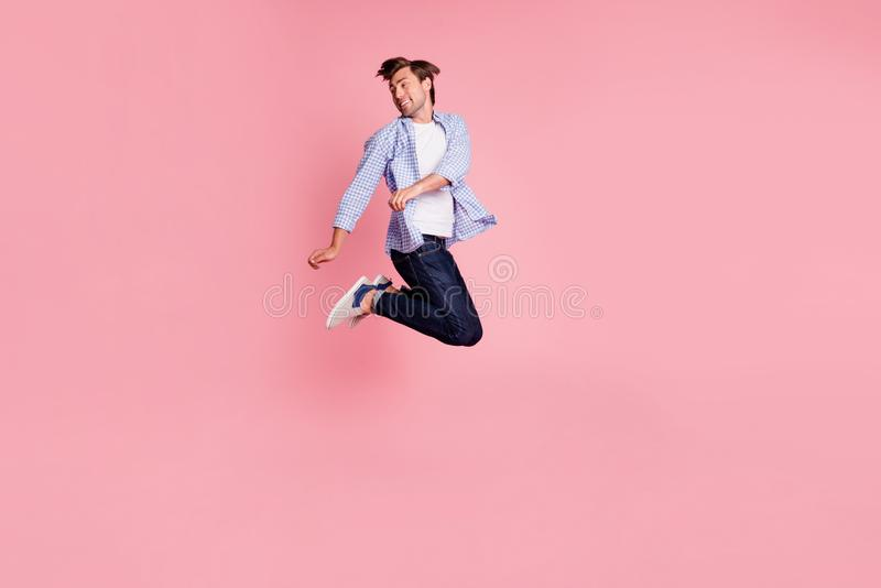 Full length body size photo of jumping high crazy he his him handsome look to empty space glad dancing dj rhythms sounds royalty free stock photography