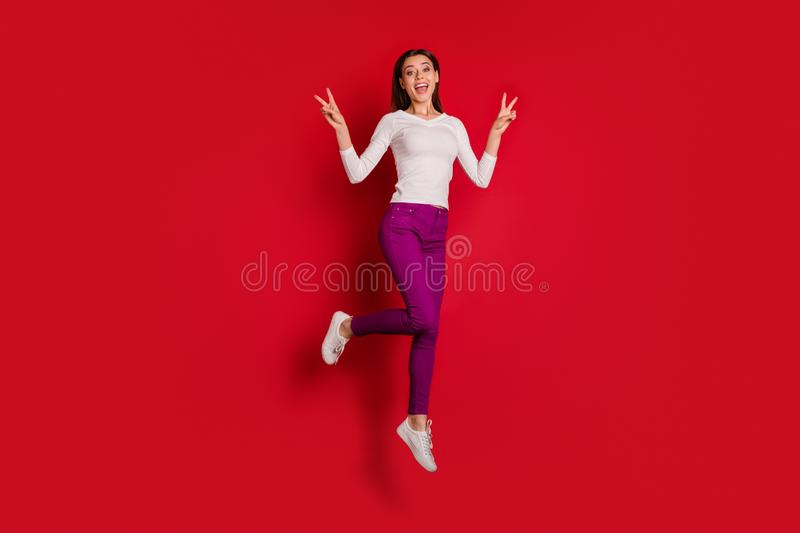 Full length body size photo of nice cute rejoicing overjoyed charming attractive woman showing you v-sign jumping in stock photos
