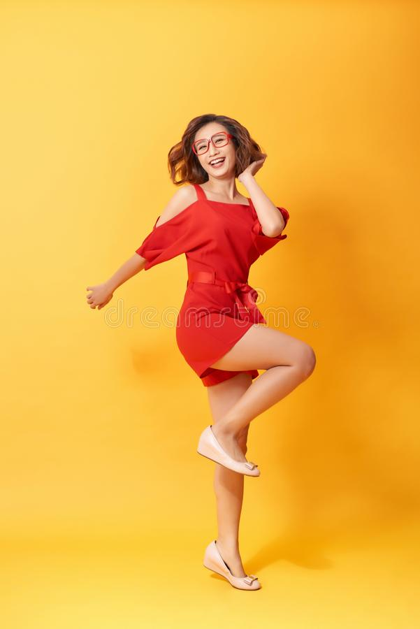 Full length body size photo of pretty charming gorgeous lovely sweet dancing isolated vivid background stock photos