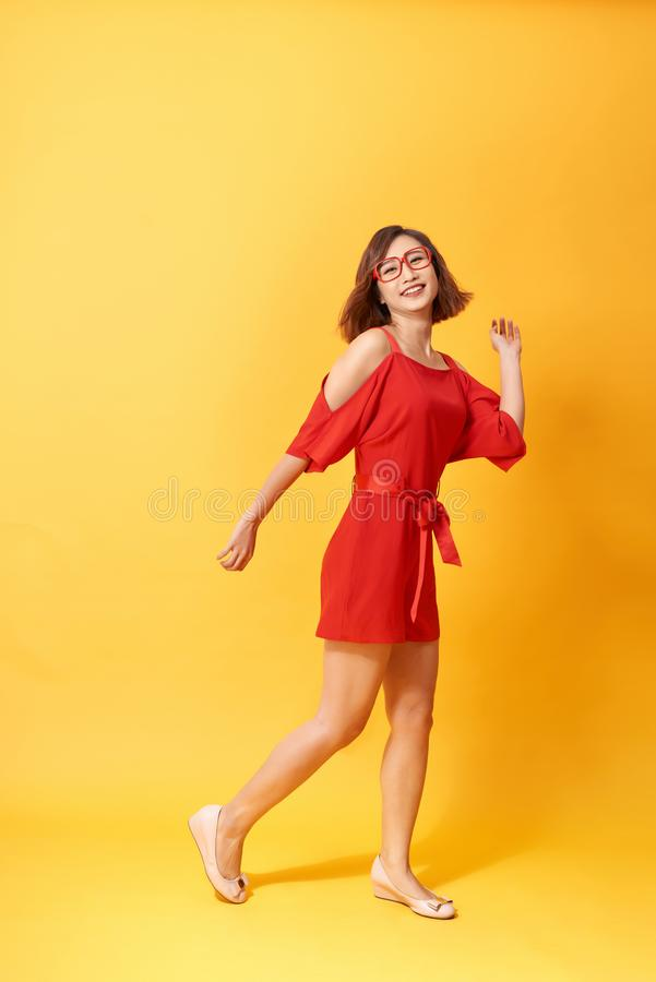 Full length body size photo of pretty charming gorgeous lovely sweet dancing isolated vivid background royalty free stock image