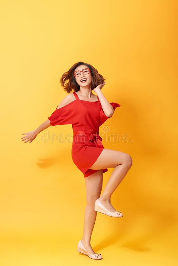 Full length body size photo of pretty charming gorgeous lovely sweet dancing isolated vivid background royalty free stock photos
