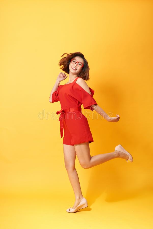 Full length body size photo of pretty charming gorgeous lovely sweet dancing isolated vivid background.  royalty free stock images