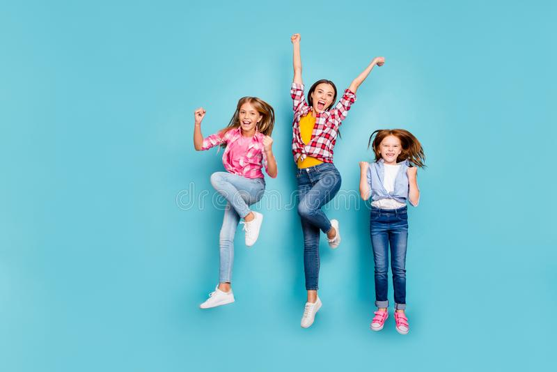 Full length body size photo of rejoicing casual white family having obviously won something wearing jeans denim while royalty free stock photos