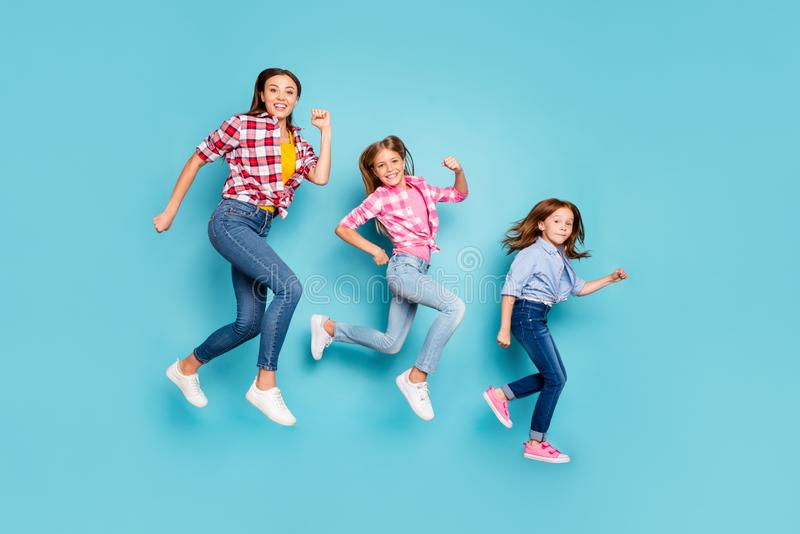 Full length body size photo of rejoicing cheerful glad white pin-up family running after each other wearing jeans denim stock photo