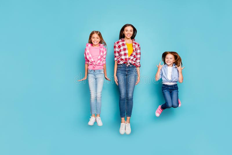 Full length body size photo of rejoicing nice white casual pin-up family spending their free time jumping wearing jeans royalty free stock image