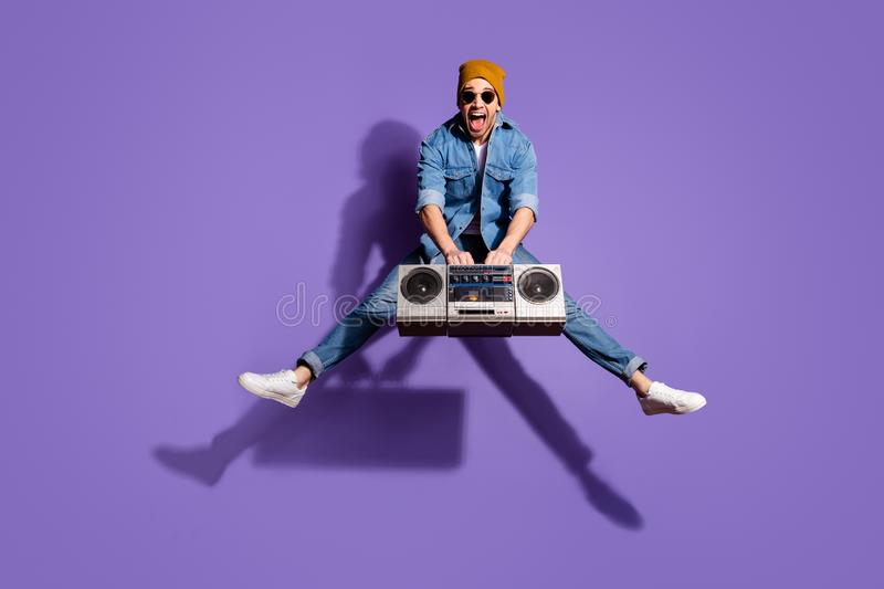 Full length body size photo of screaming cheerful handsome attractive music lover shouting with having won retro stock images
