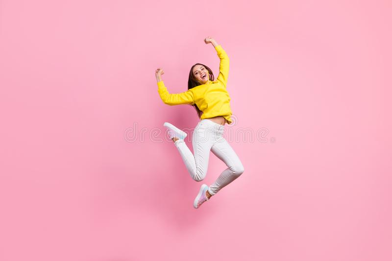 Full length body size photo of trendy pretty cute girlfriend wearing pants trousers yellow sweater footwear rejoicing. Full length body size photo of trendy stock photos