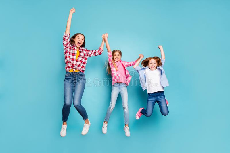 Full length body size photo of two rejoicing daughters with mother winning rejoicing white wearing jeans denim while stock image