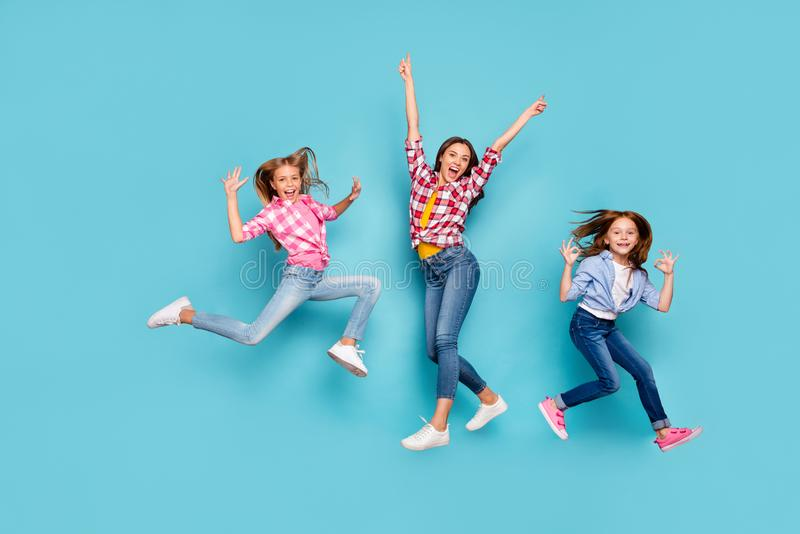 Full length body size photo of white cheerful nice family enjoying their lives wearing jeans denim casually while stock images