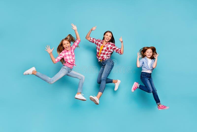 Full length body size photo of white rejoicing overjoyed winning family having given feedback on something wearing jeans stock image