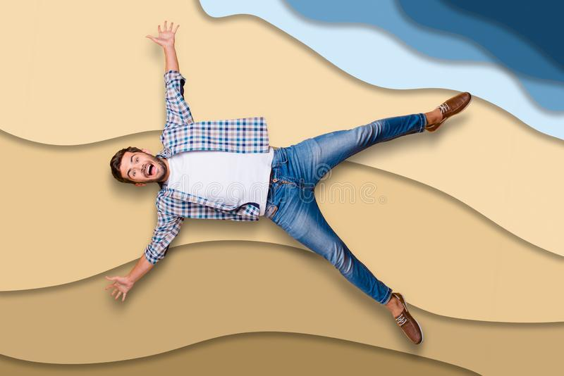 Full length body size portrait of cool crazy cheerful handsome man jumping up like a star enjoying summer weekend ocean royalty free stock photos