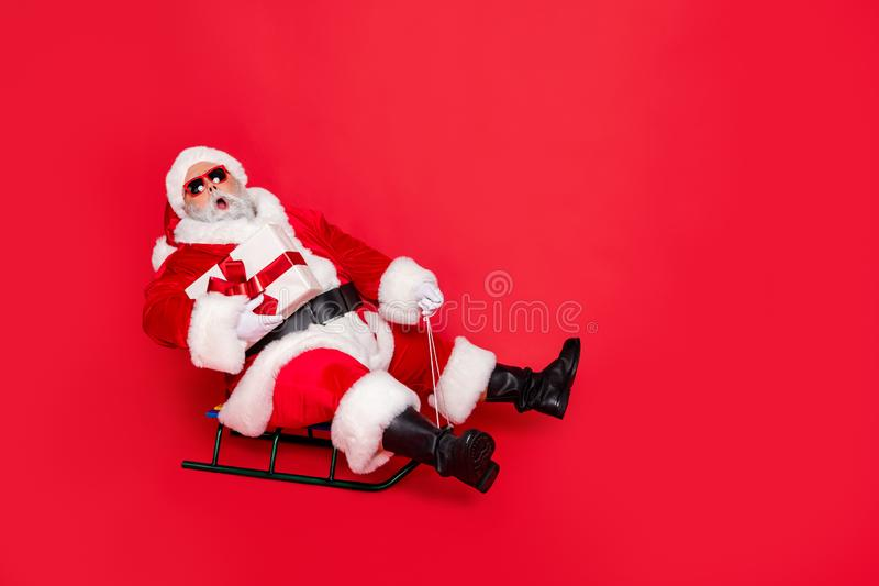 Full length body size view of amazed stunned kind funky fat overweight plump gray-haired bearded man sledging carrying stock photos