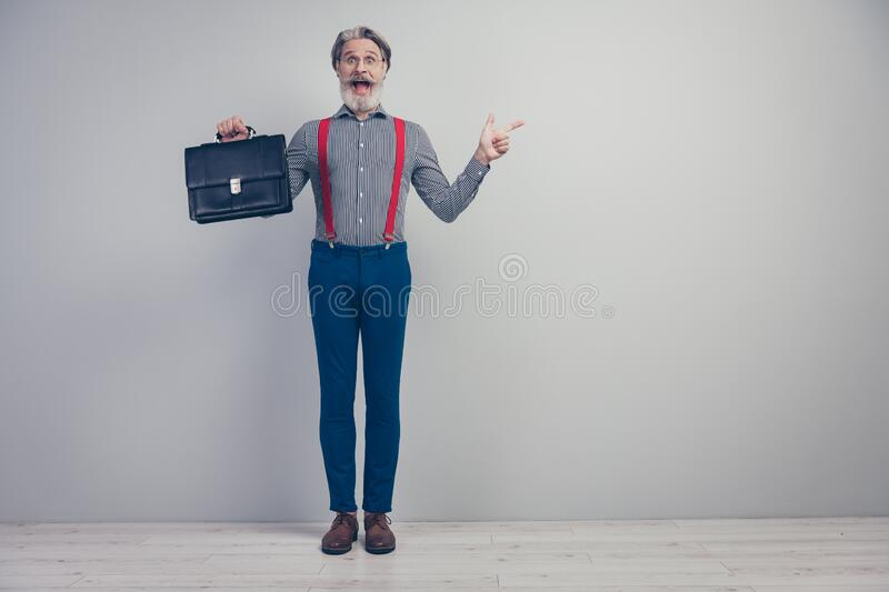Full length body size view of his he nice attractive cheerful cheery amazed overjoyed man carrying briefcase pointing. Full length body size view of his he nice royalty free stock image