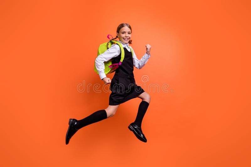 Full length body size view of nice attractive lovely cheerful cheery glad diligent pre-teen girl nerd running fast first. Full length body size view of nice stock photo