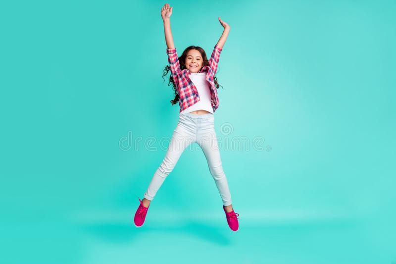 Full length body size view photo cute sweet girl raise hands careless enjoy travel trip funny funky positive content. Stretch arms checked shirt modern white stock photography