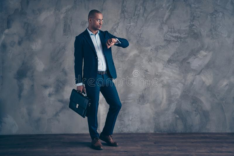 Full length body size view photo real estate manager serious briefing look watch take diplomat management concept. Deadline punctual impatient wear modern royalty free stock photography