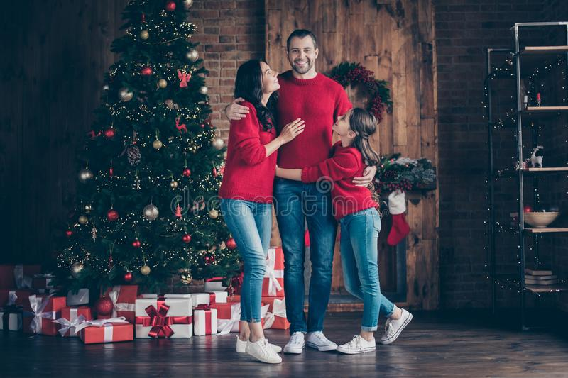 Full length body size view of three nice attractive lovely sweet careful glad cheerful cheery family mom dad spending. Celebrating, vacation tradition decorated royalty free stock photography