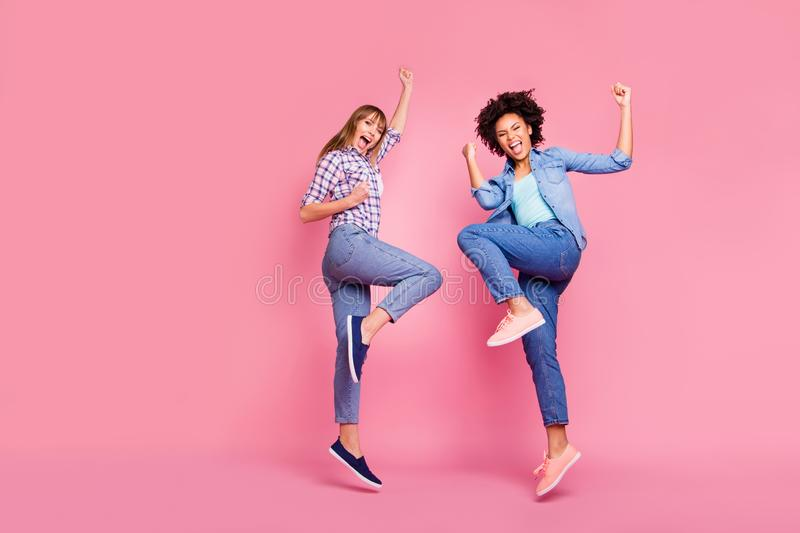 Full length body size view of two person nice crazy charming cheerful cheery ecstatic girls raising hands up having fun royalty free stock image