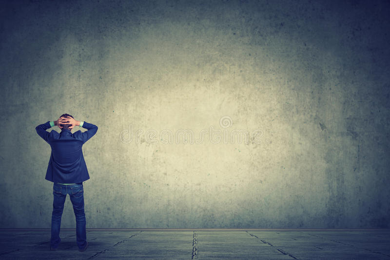 Full length of business man facing the wall royalty free stock images