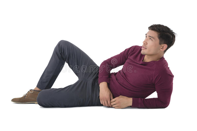 Full length of businessman reclining while looking away stock images