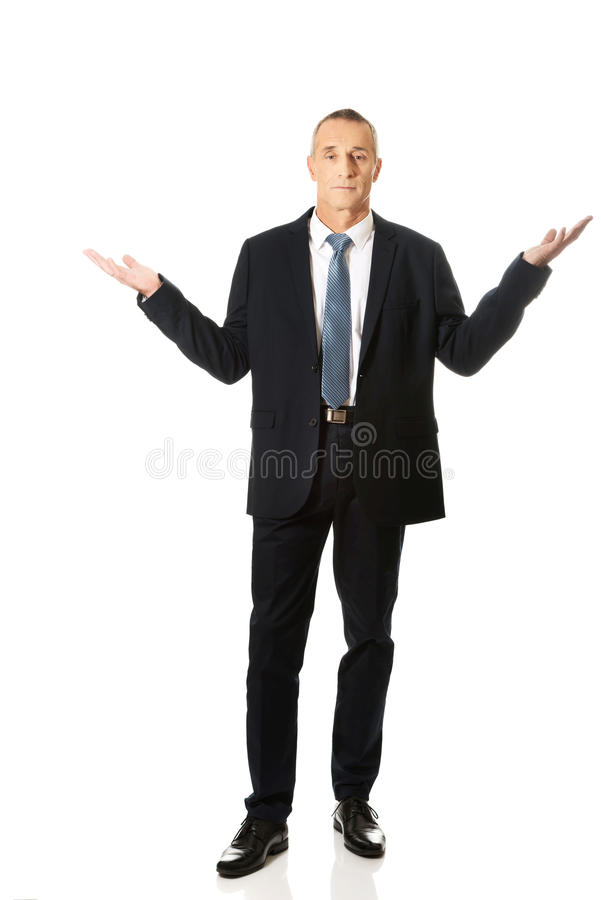 Full length businessman in undecided gesture stock images
