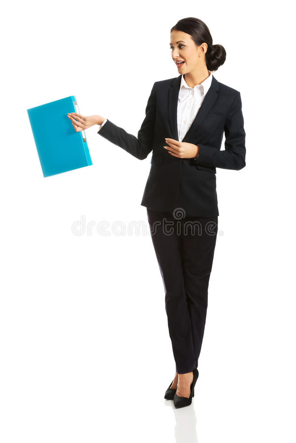 Full length businesswoman holding a binder stock images