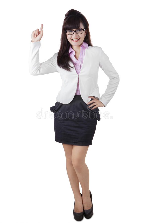 Full length of businesswoman pointing an idea royalty free stock images
