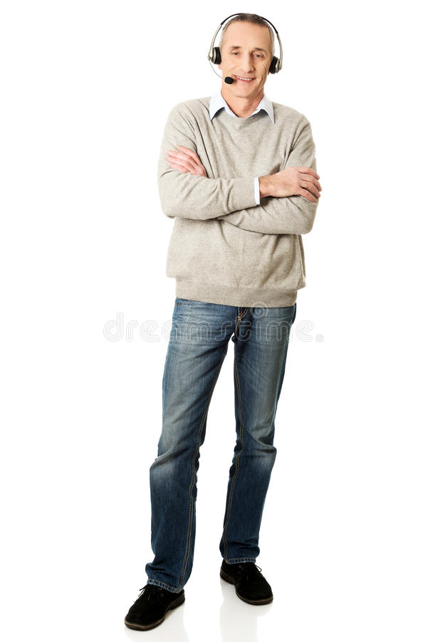 Full length of call center man with folded arms stock photo