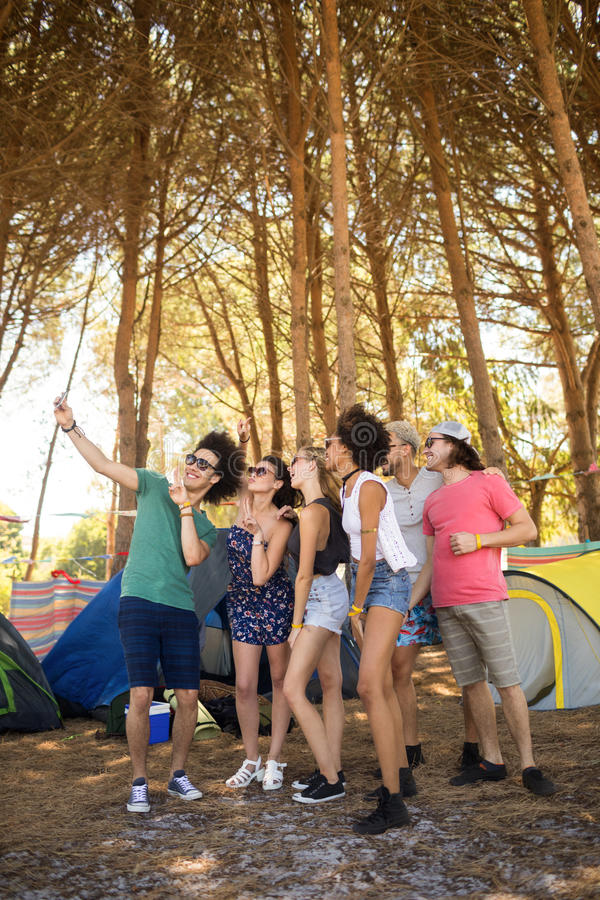 Full length of cheerful friends taking selfie at campsite stock photos