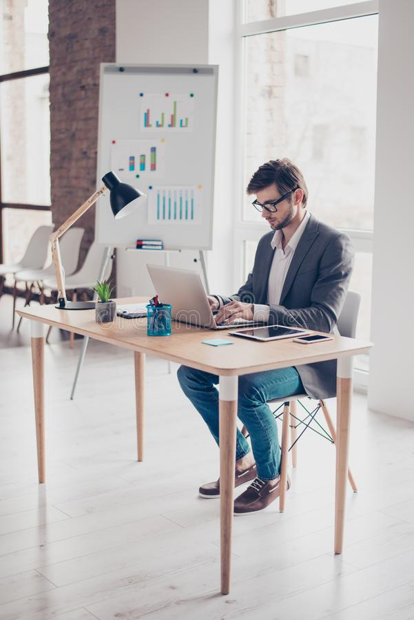 Full length of concentrated young businessman, which is browsing royalty free stock images