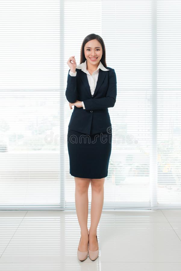 Full length of confident beautiful young asian woman looking at royalty free stock photos