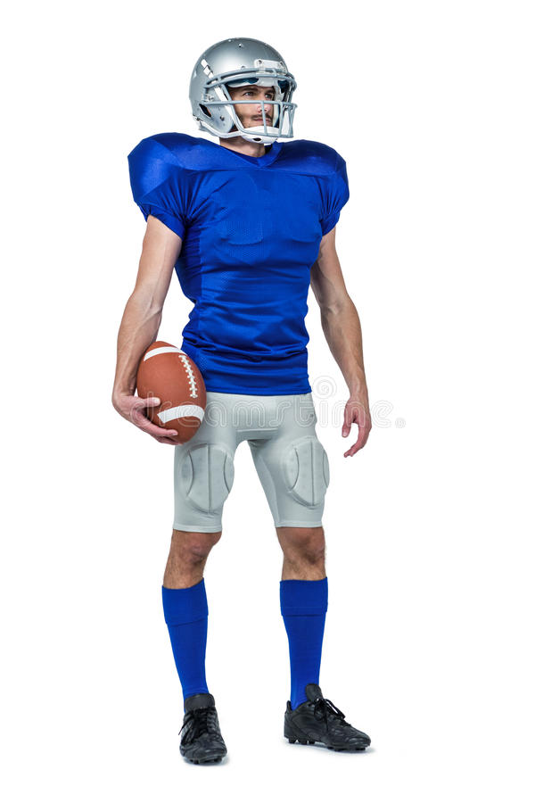 Full length of confident sport man to holding ball stock photo
