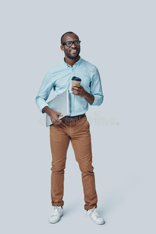 Full length of confident young African man stock photography