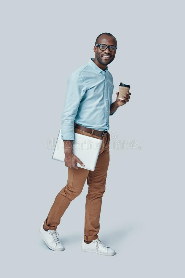 Full length of confident young African man stock images