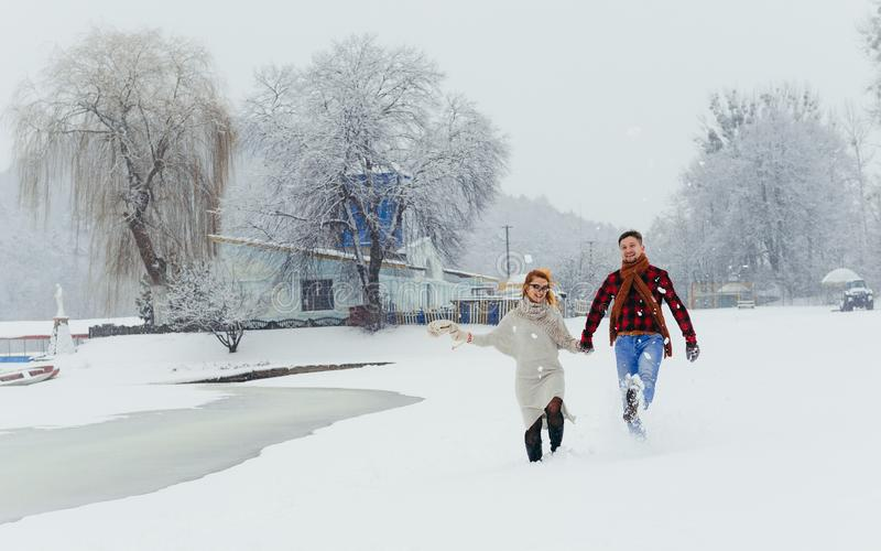 Full Length Couple Happy Smiling Laughing Holding Hands Walking Winter Snow Portrait Meadow Landscape Christmas New Year stock images