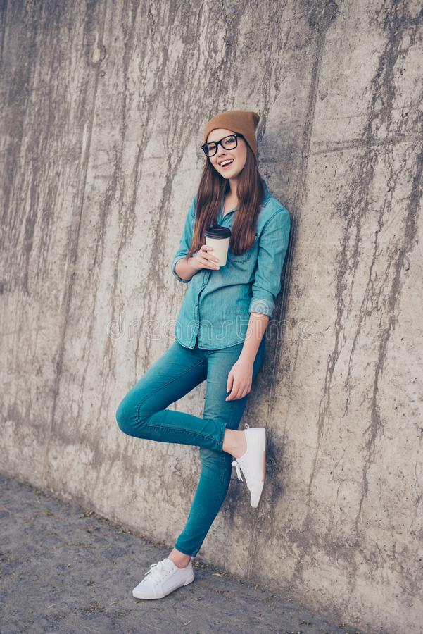 Full length of excited girl, standing near concrete wall outside royalty free stock images