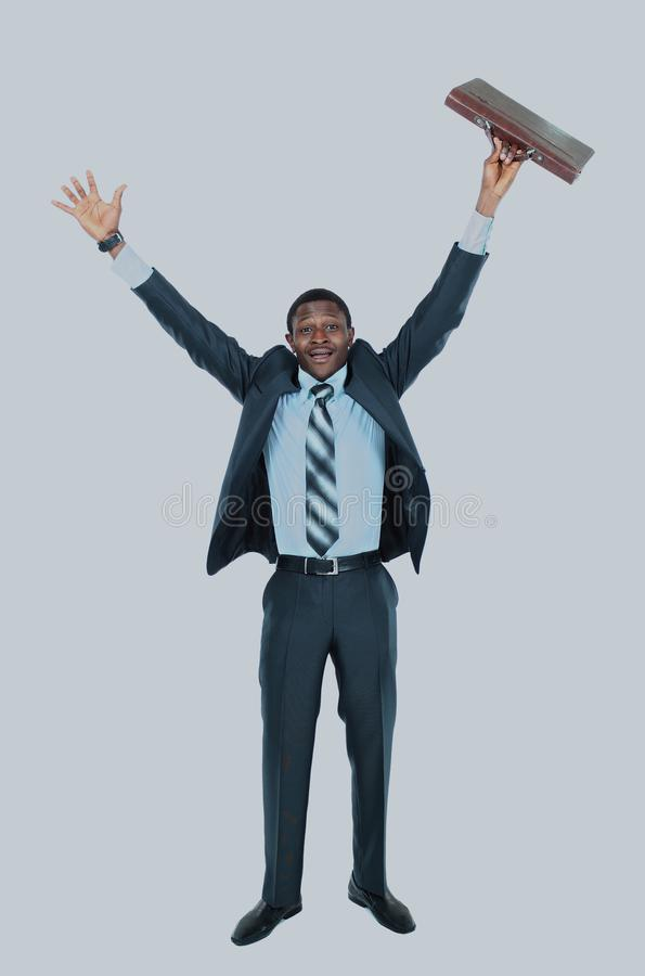 Full length of an excited handsome business man with arms raised in success - Isolated on white. Full length of an excited handsome business man with arms royalty free stock image