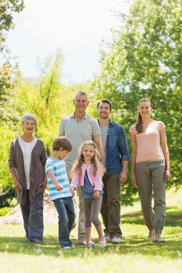 Full length of family walking in park royalty free stock images