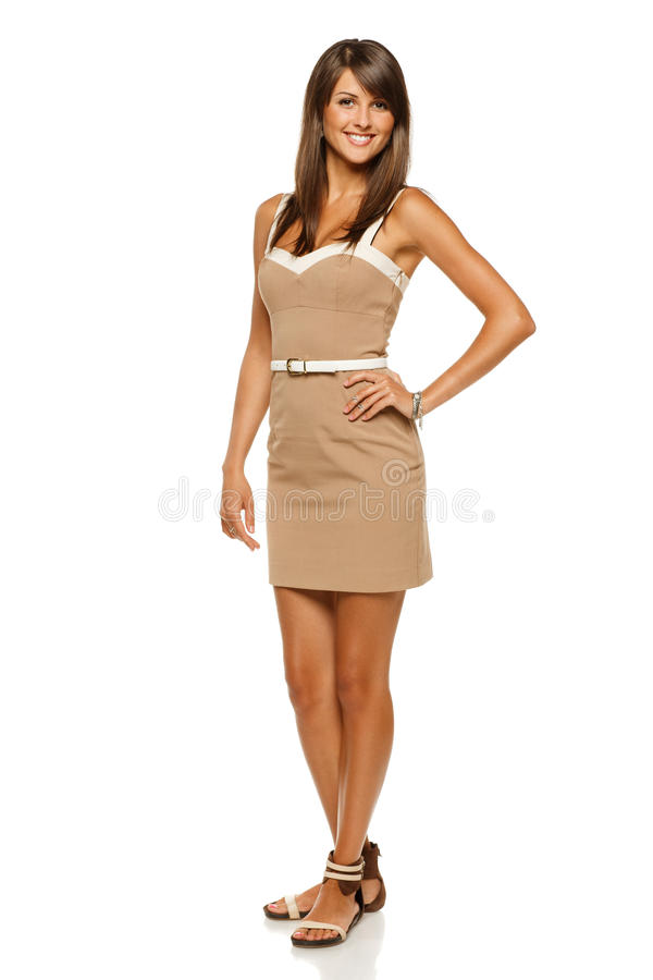 Full length of female in beige dress