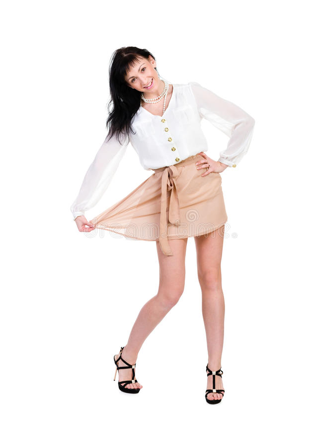 Full length of friendly smiling girl posing stock image