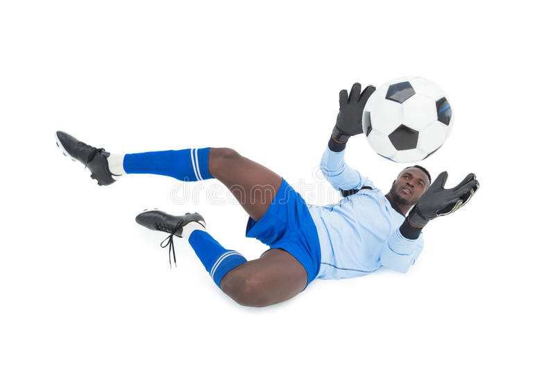Full length of goal keeper in action stock photography
